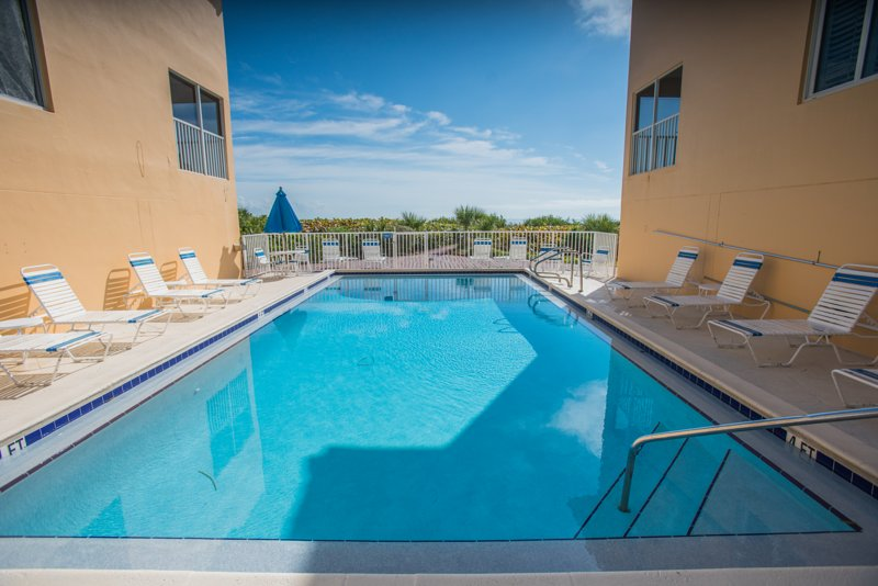 Spend The Day Relaxing At This Large And Serene Heated Pool That Overlooks Beach