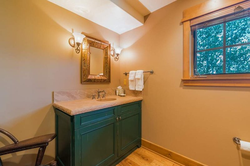 There's a convenient powder and laundry room just off from the living area.