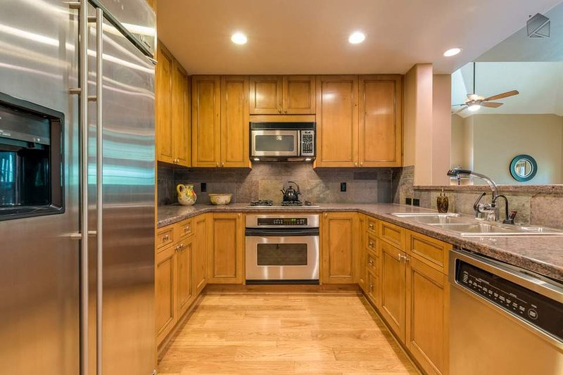 The galley-style kitchen has plenty of counter space for preparing large meals.
