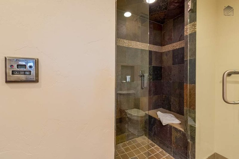 The Master Bathroom was built for relaxation, and features a lavish steam shower.