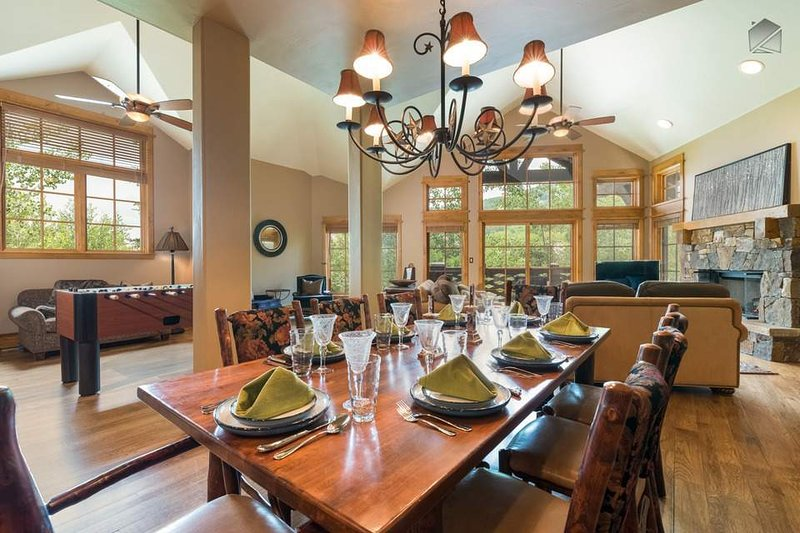 A sumptuous wood dining table can seat up to eight guests.