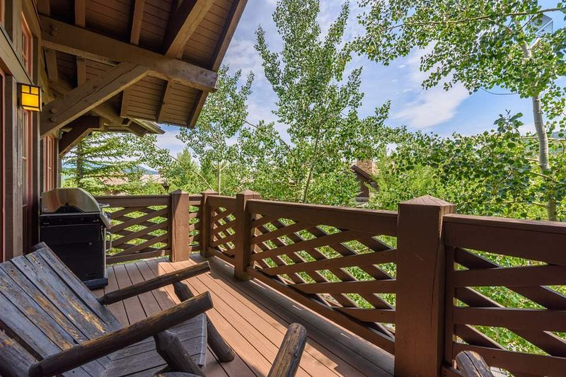From the deck, look out over the tops of aspens to the ridges beyond.