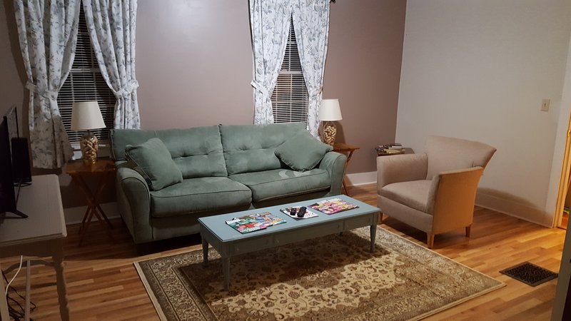sunny living room, new hardwood floors, just redecorated!