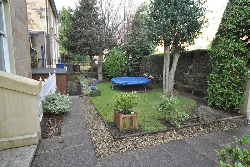 Garden with seating area for summer.