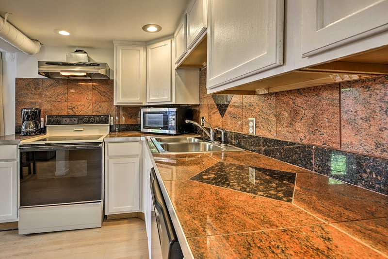 This vacation rental features a fully equipped kitchen and other amenities.