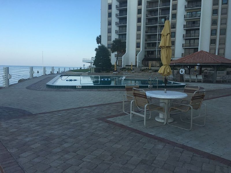 There is a large patio and heated swimming pool overlooking the ocean.