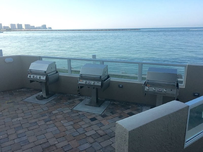 Outdoor grills and seating for a comfortable ocean side meal.