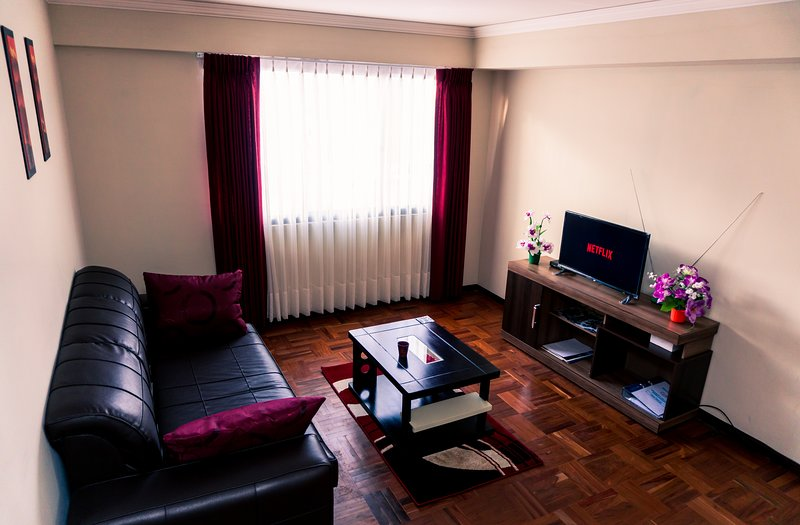 Living room: sofa, dining table and Smart TV