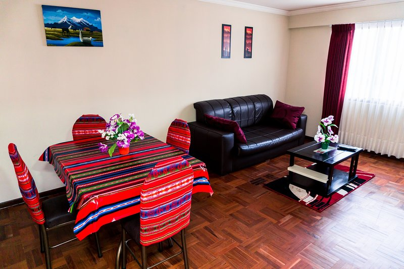 Living room: sofa and dining table