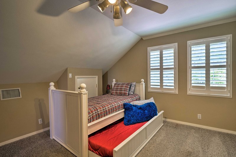 Another bedroom includes a twin bed and trundle.