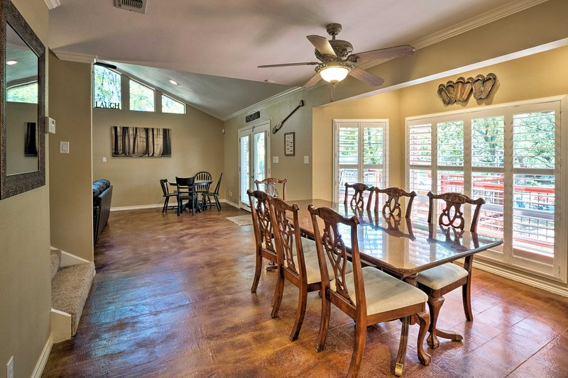 This dining table seats 8, while another accommodates 4 guests.