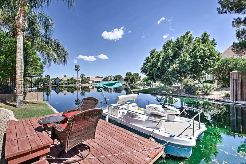 The 4-bed, 2-bath home even has a pontoon boat available for your use.