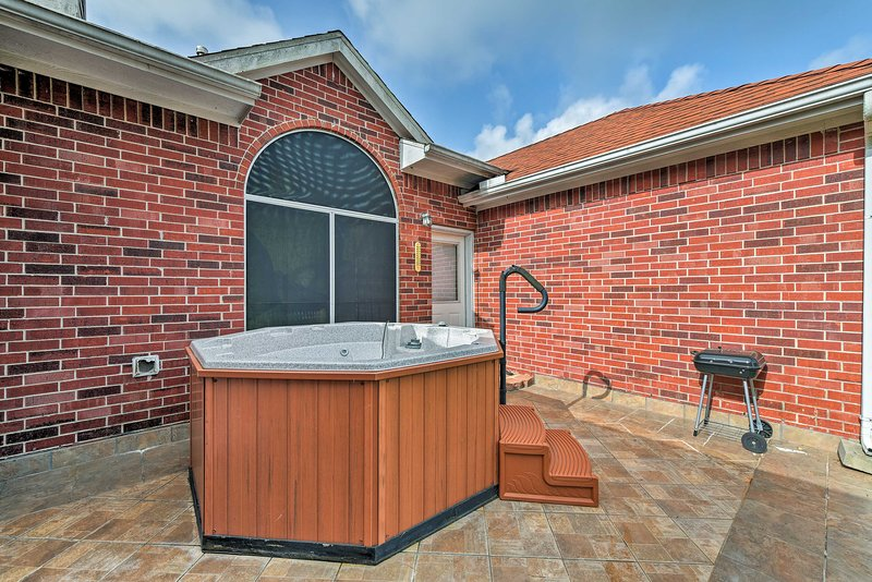 This home is brimming with amenities, including a grill and hot tub!