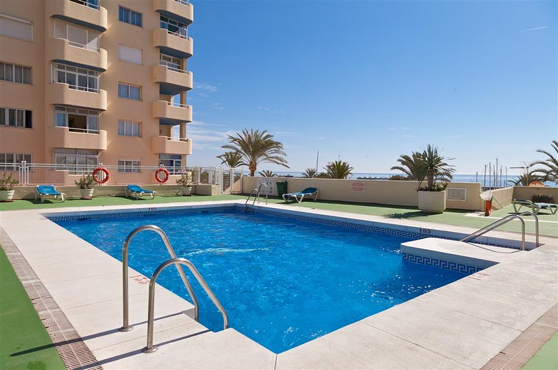 Inviting communal swimming pool with sunloungers provided