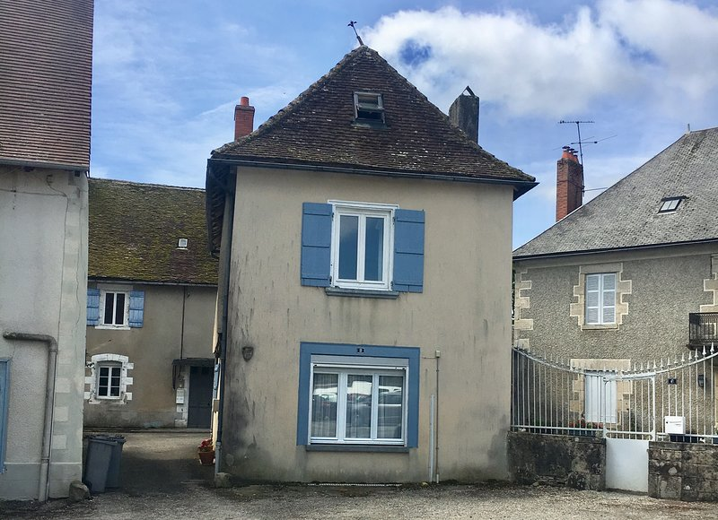 Detached village house built over the old city wall, opposite a medieval church
