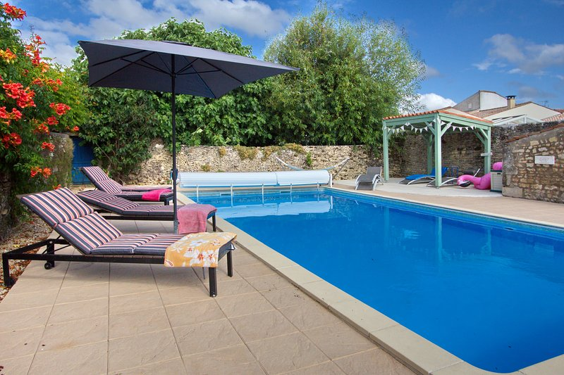 Private heated pool with shaded pergola