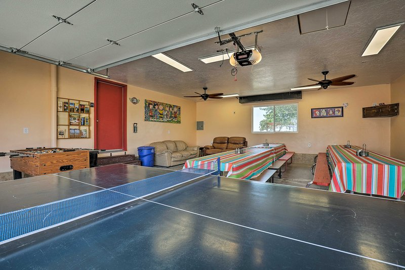 Two large dining tables to seat over 40 plus couches/TV on wall Ping Pong and Fooz ball Tables