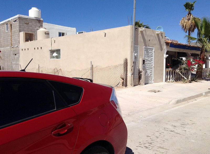 Street view of stand alone casita with street parking in front.