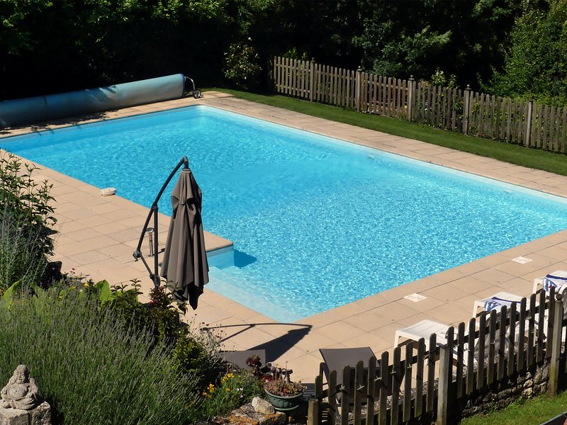 The heated pool at L Ecurie Holiday Home