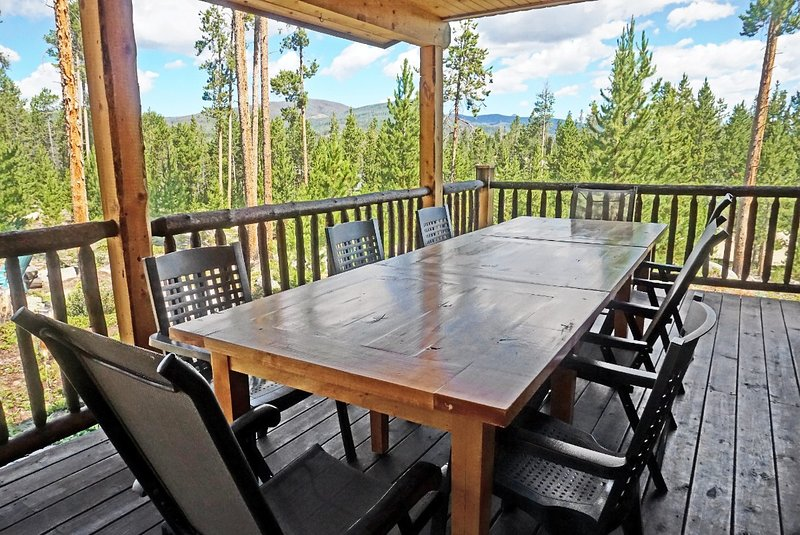 Covered deck and outdoor dining area with views