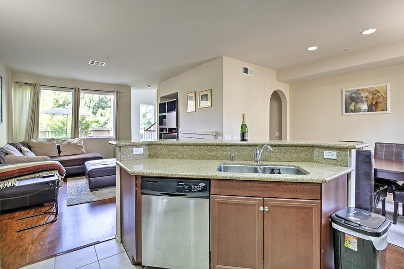 The space features stainless steel appliances and granite counters.