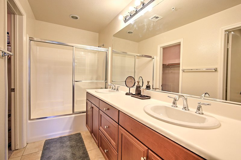 Rinse off in the shower/tub combo. You'll enjoy the ample counter space.