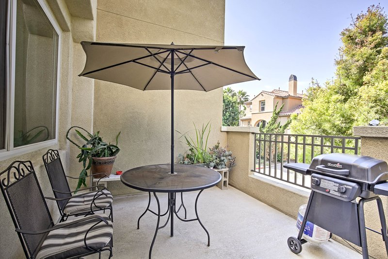 Sit out on the private balcony under the shade of the umbrella and grill.