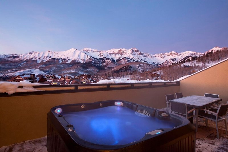 Your private balcony has breathtaking views of Sneffels Highline and a private hot tub.