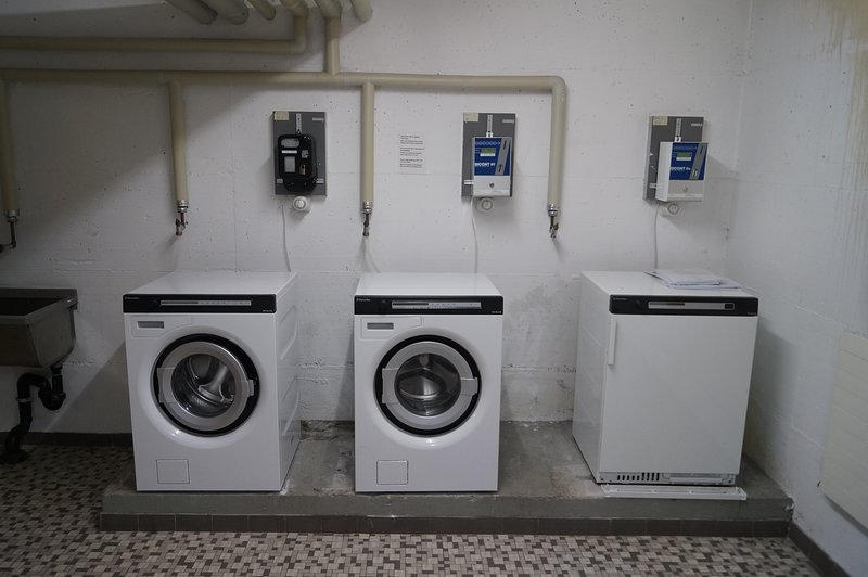 There is a coin operated washing machine and dryer available.
