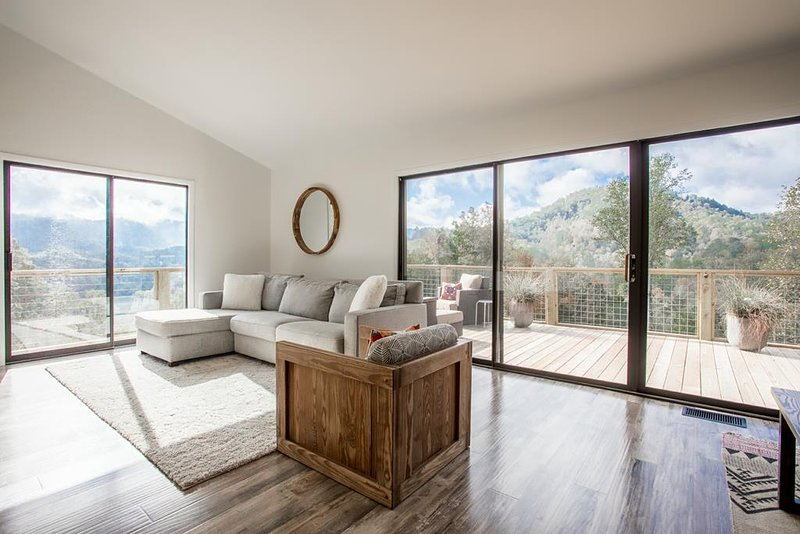 Tons of natural light flood the hip living room