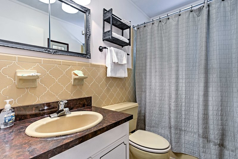 Rinse off the day in this en-suite bathroom.