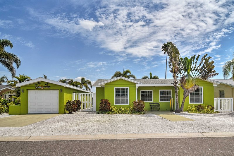 The home features a prime location just a short walk from the beach.