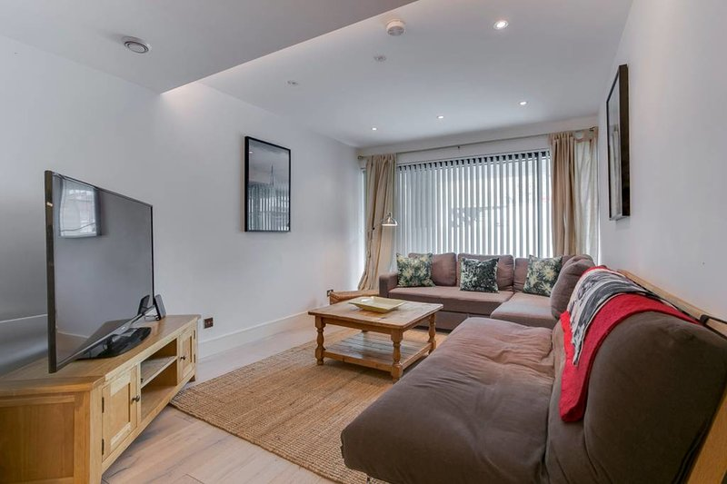 Kick back on the sofa and unwind in front of the flat screen TV!