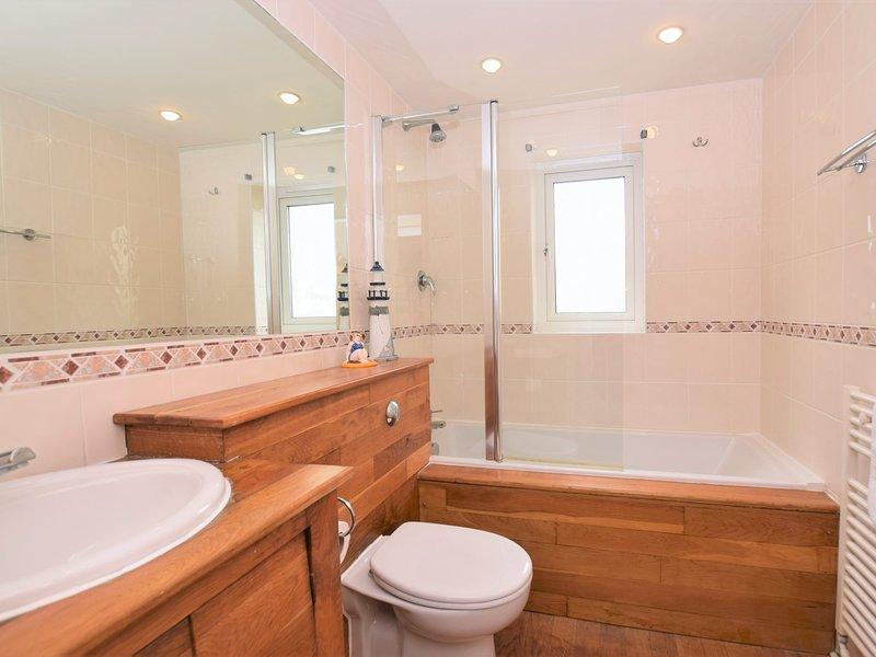 Contemporary en-suites for both bedrooms