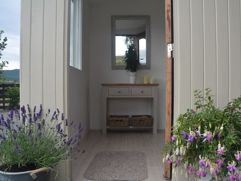 Entering this stylish detached charming cottage