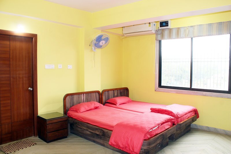 Deluxe AC Twin Room with Attached Toilet