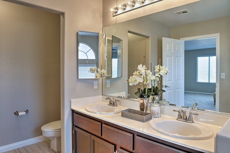The master bath also has a dual-sink vanity and separate toilet.
