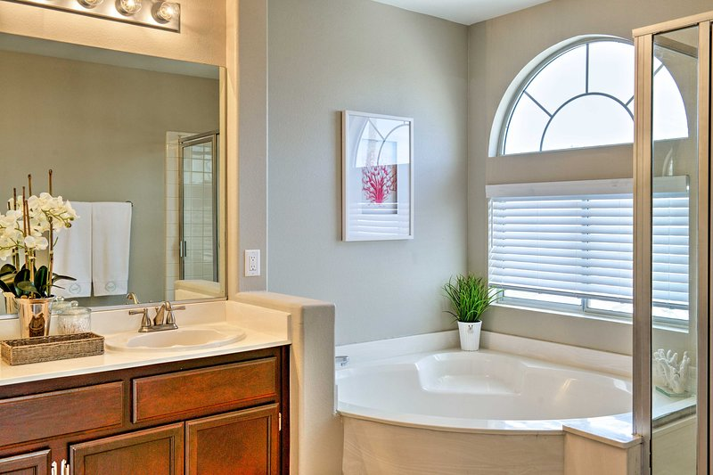 You'll love the luxury of this en-suite master bath, with soaking tub and shower