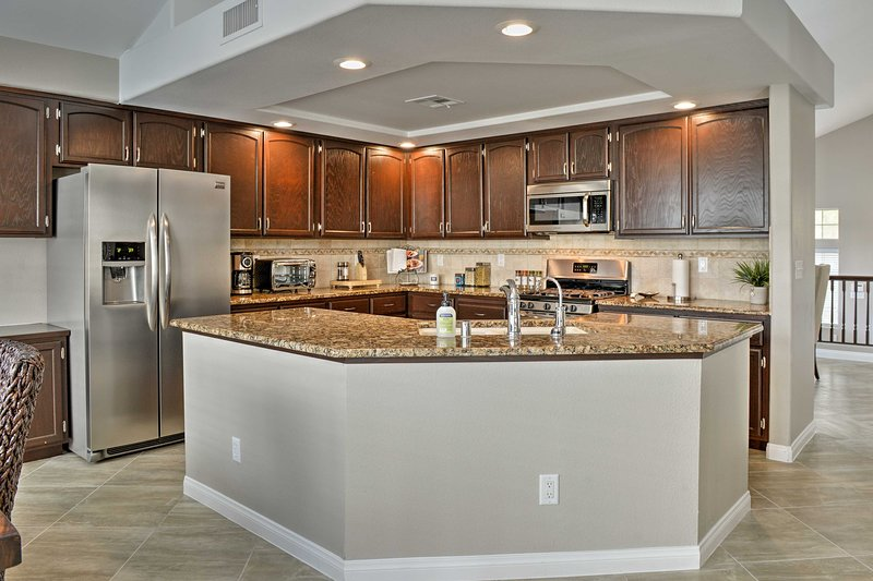 Stainless steel appliances, granite counters & all the culinary essentials await