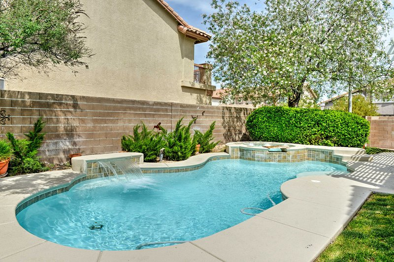 Relish in the desert sunshine by the home's private outdoor pool
