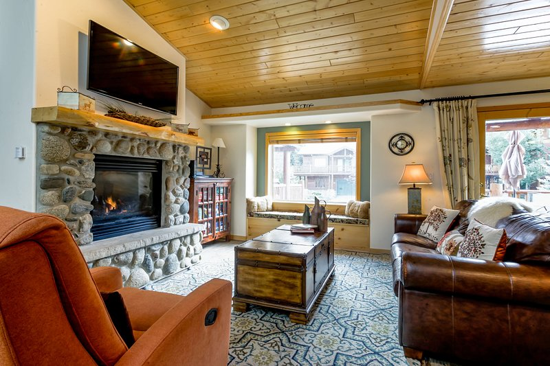 An inviting lounge with new furnishings by the fireplace