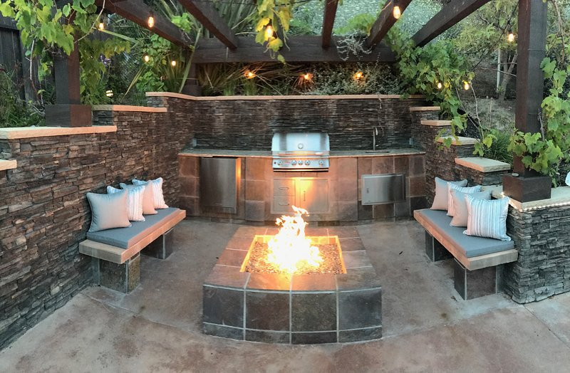 Gas burning fire pit with built in BBQ