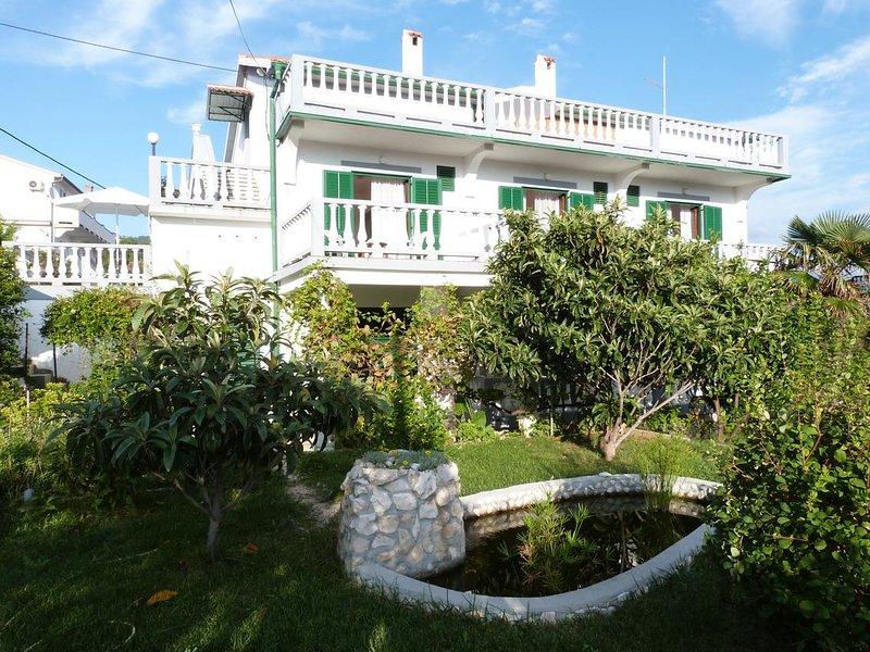 Two bedroom apartment Palit, Rab (A-14996-b), location de vacances à La ville de Rab