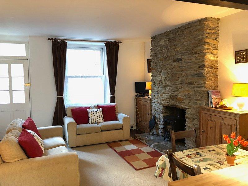 Open plan lounge/kitchen/diner with woodburner