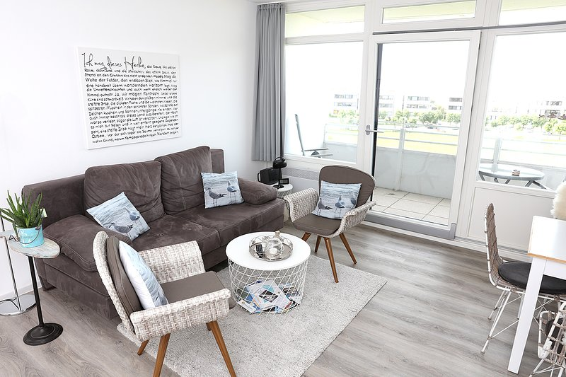 Living room corner and balcony in the beach hut Fehmarn