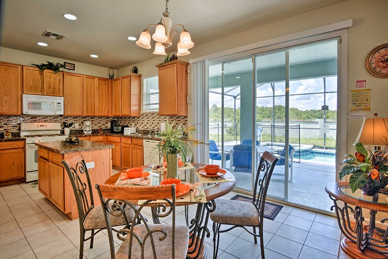 Natural light pours into the breakfast nook area.