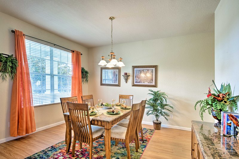 This lovely dining room boasts enough seating for 6.