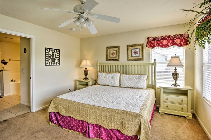 Afternoon naps are always welcome in this king master bedroom.