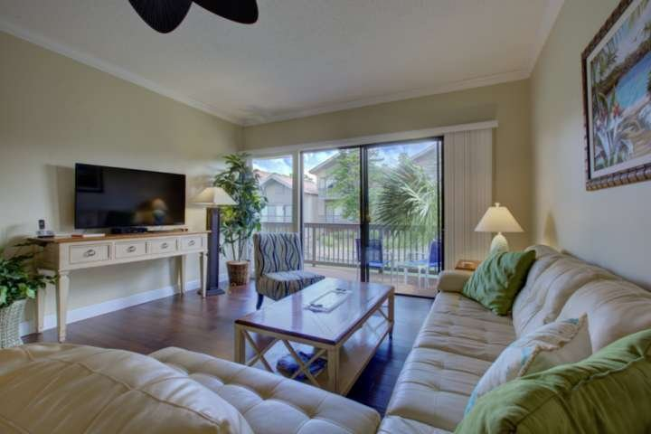 Plenty of comfortable seating in the living room with a large flatscreen TV for family movie nights.