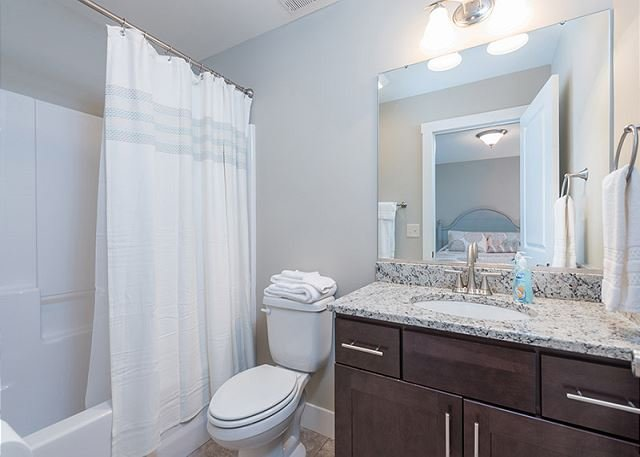 Bathroom with tub and shower in second queen bedroom.